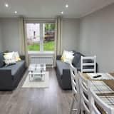 Deluxe appartement, Meerdere bedden, Toegankelijk voor mindervaliden, uitzicht op tuin - Woonkamer
