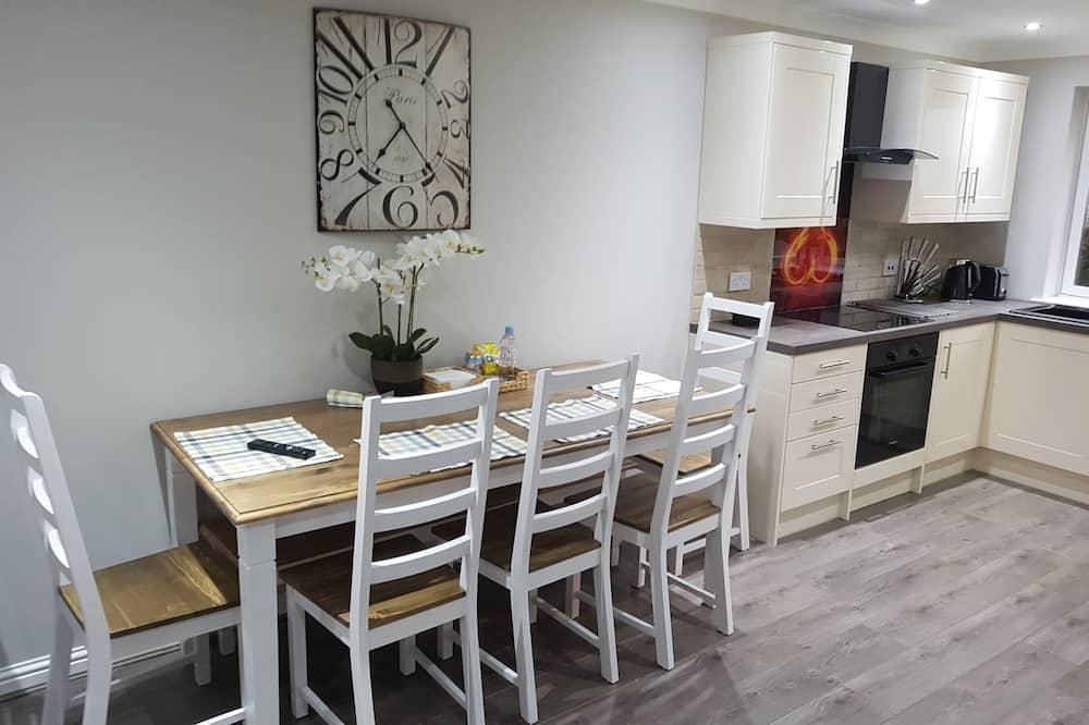 Deluxe appartement, Meerdere bedden, Toegankelijk voor mindervaliden, uitzicht op tuin - Woonruimte