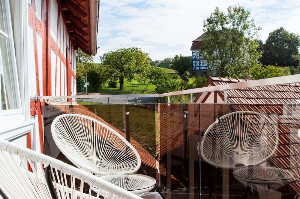 Apartamentai, 2 miegamieji, balkonas, vaizdas į sodą - Balkonas