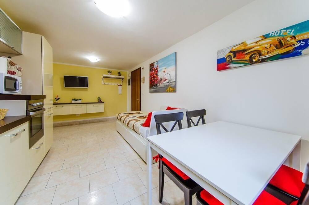 Апартаменты, Несколько кроватей, для некурящих - Зона гостиной