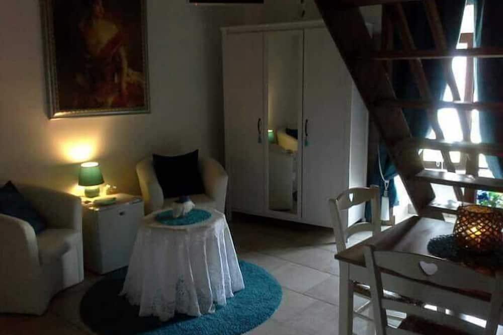 Pokoj typu Deluxe - Obývací prostor