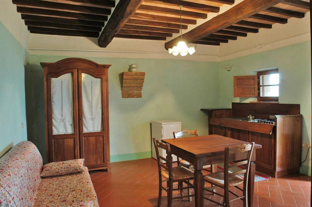 شقة - غرفة نوم واحدة - في الطابق الأرضي - منطقة المعيشة