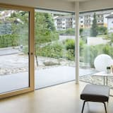 Апартаменты, балкон - Зона гостиной