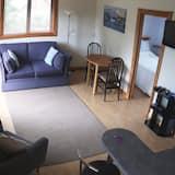 Apartmán, dvojlůžko (180 cm) a rozkládací pohovka, nekuřácký - Obývací prostor