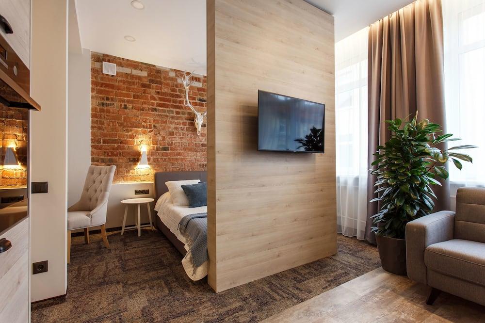 Семейные апартаменты, 1 двуспальная кровать «Квин-сайз», для некурящих - Зона гостиной