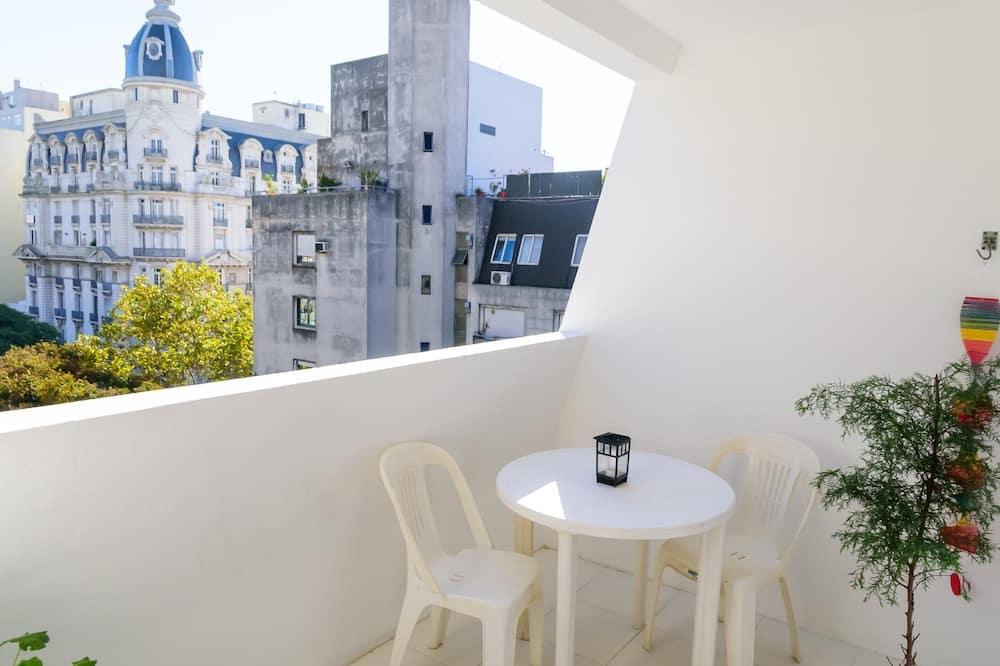 Familie appartement, Meerdere bedden, niet-roken, Uitzicht op de stad - Balkon