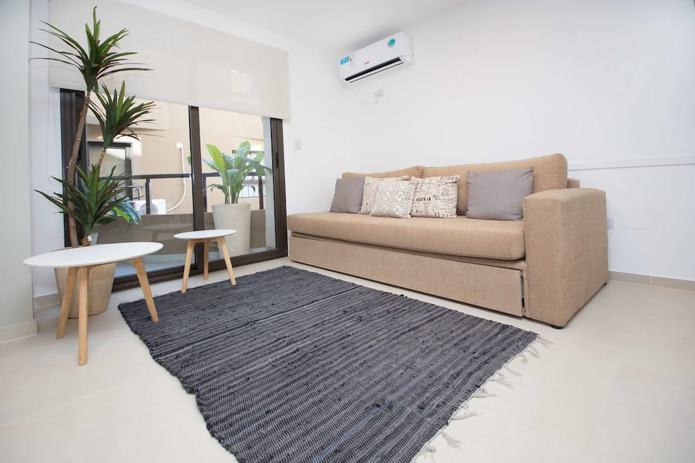 Apartment, Mehrere Betten, Nichtraucher, Stadtblick - Wohnzimmer