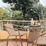 Basic-rum - 1 kingsize-säng - utsikt mot trädgården - Balkong