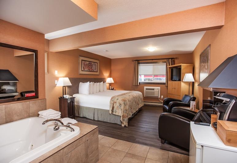 Swiss Chalet Motel, Revelstoke, Premium-værelse - 1 kingsize-seng - ikke-ryger, Værelse