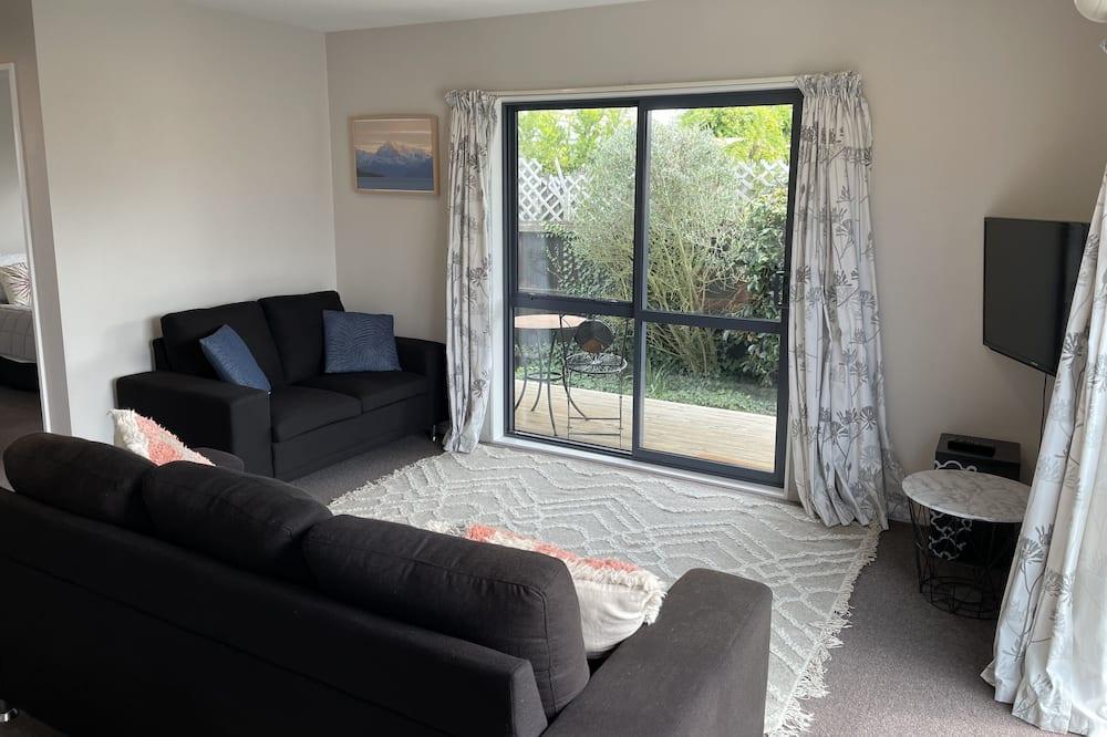 Casa básica, Varias camas, vista al jardín - Sala de estar