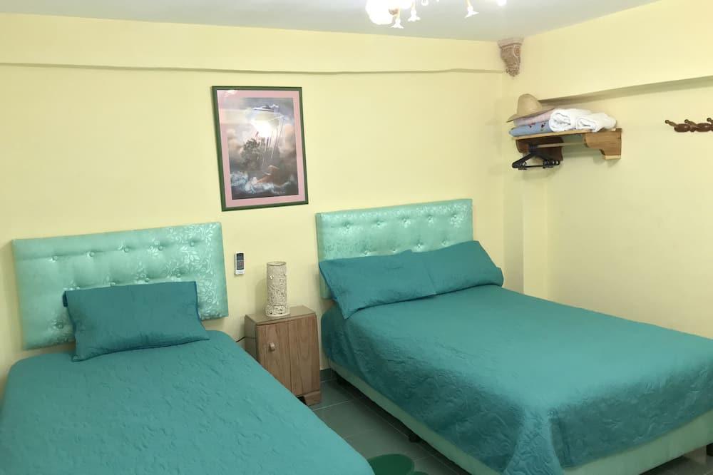 Habitación Confort, 1 cama Queen size, para no fumadores, vista al jardín - Vista de la habitación