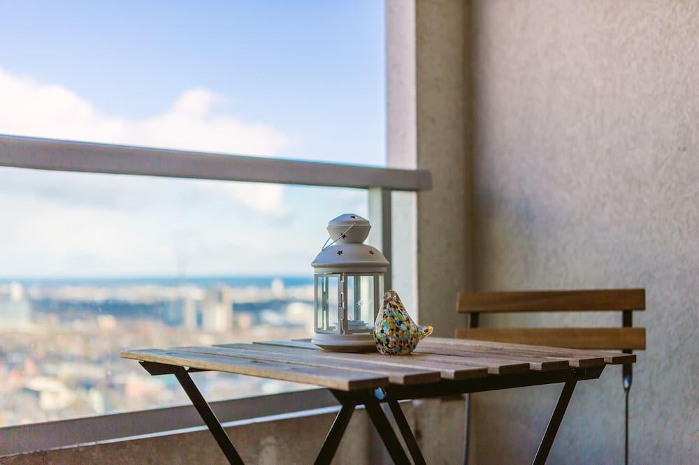 Leilighet – deluxe, flere senger, ikke-røyk, utsikt mot byen - Balkong