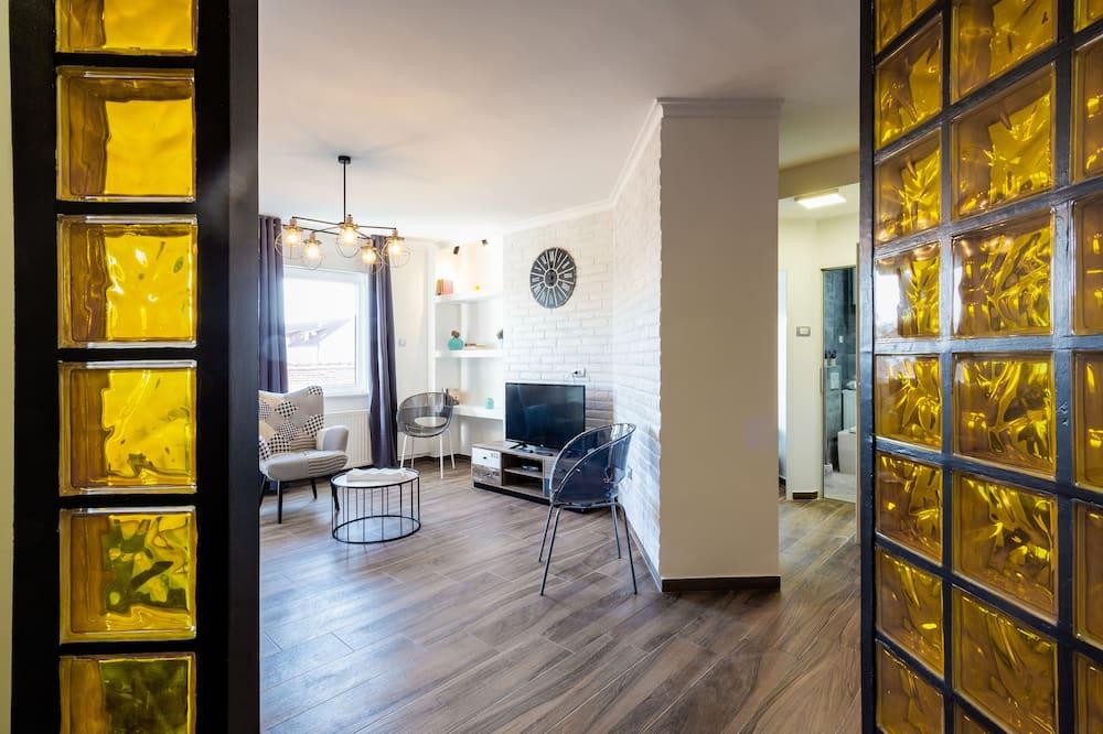 Apartamento Deluxe - Zona de estar