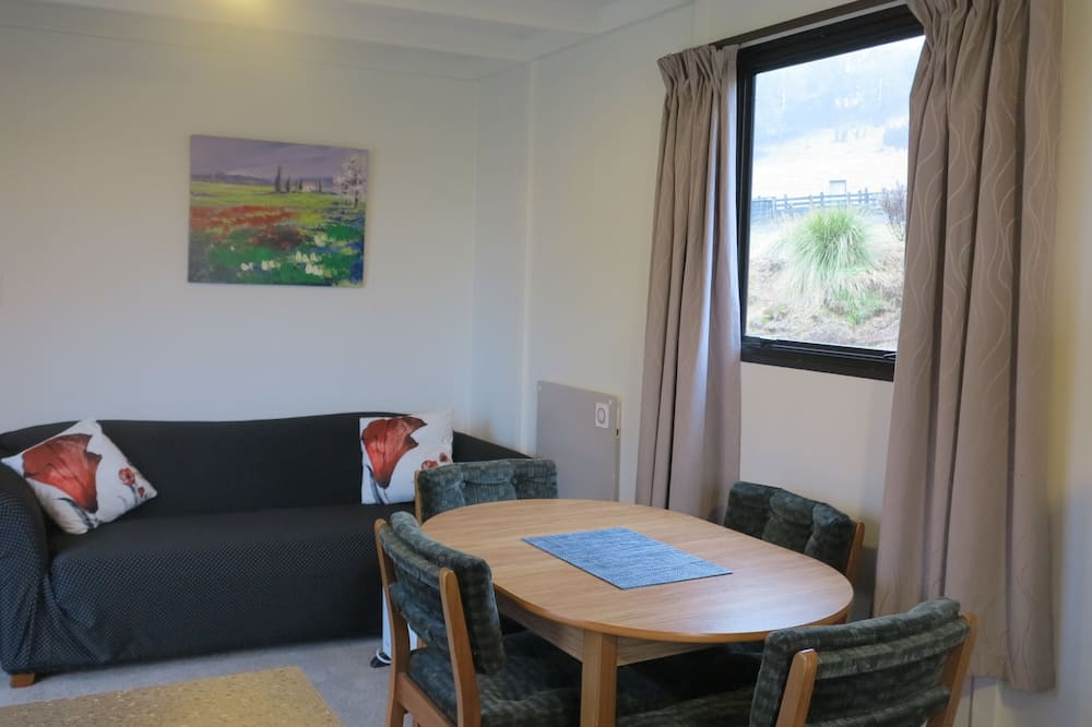 Panorama-feriehus - flere senge - bjergudsigt - Opholdsområde
