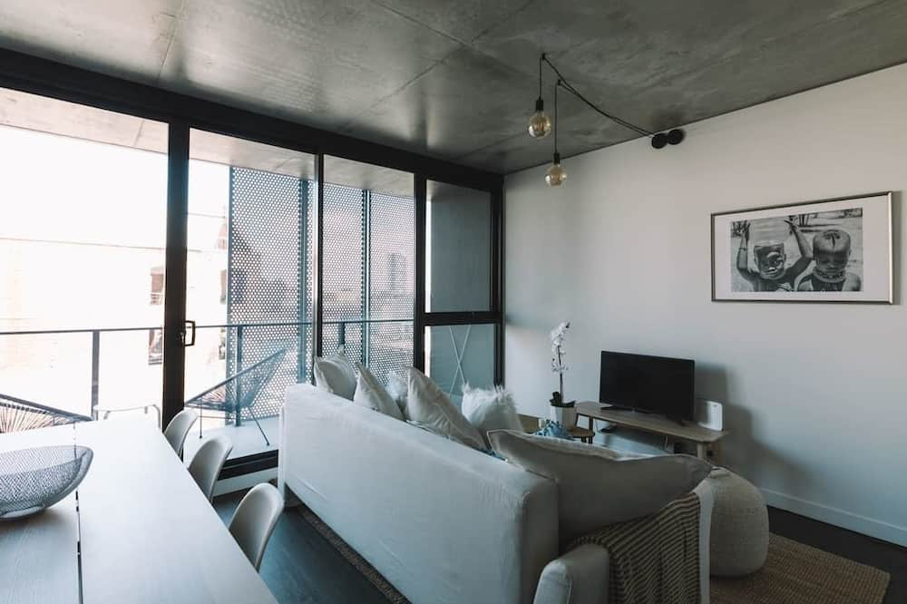 Deluxe appartement, 1 slaapkamer - Woonkamer