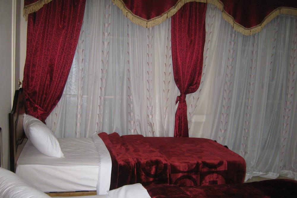 Habitación con 1 cama doble o 2 individuales - Vista a la ciudad