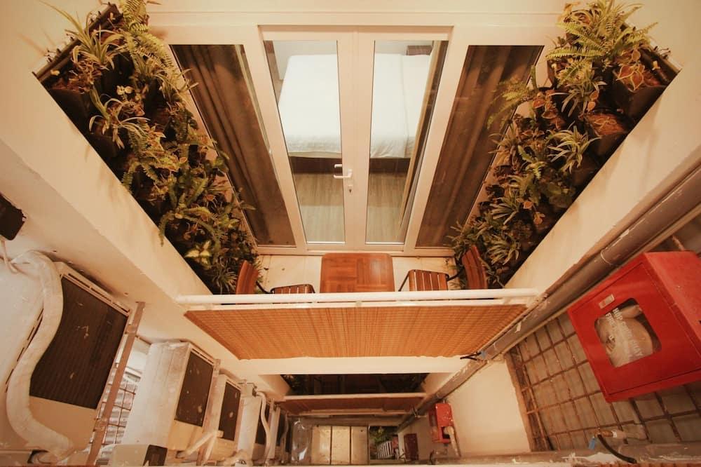 Deluxe-Doppel- oder -Zweibettzimmer, Balkon - Wohnbereich