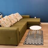 デザイン アパートメント クイーンベッド 1 台ソファーベッド付き 禁煙 シティビュー - リビング エリア