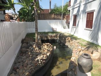 Mynd af Queen's House í Luang Prabang