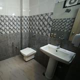 Deluxe AC Rooms with Balcony - Bathroom