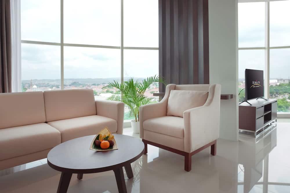 Suite junior, vista a la ciudad - Sala de estar