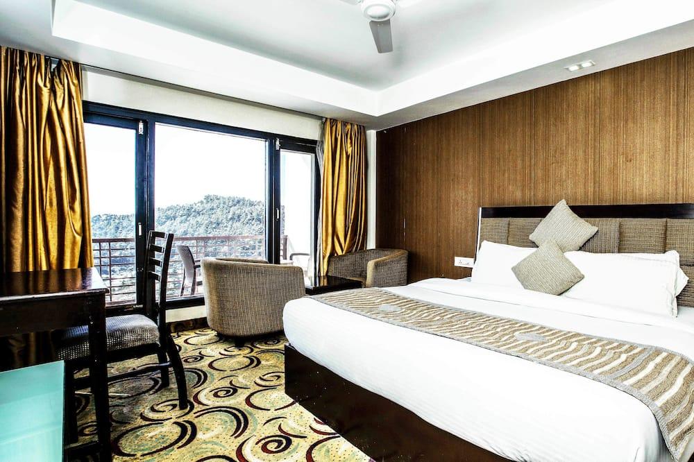 Номер-люкс із покращеним обслуговуванням, 1 ліжко «кінг-сайз», для некурців, з видом на гори - Житлова площа