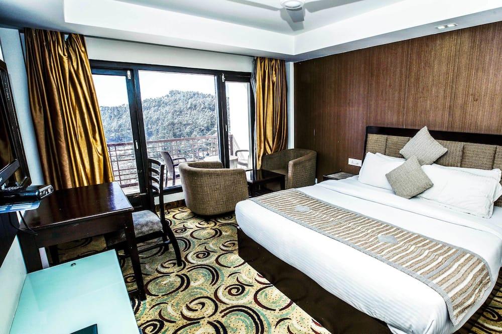 Двомісний номер із покращеним обслуговуванням, 1 односпальне ліжко, для некурців, з видом на гори - Вітальня