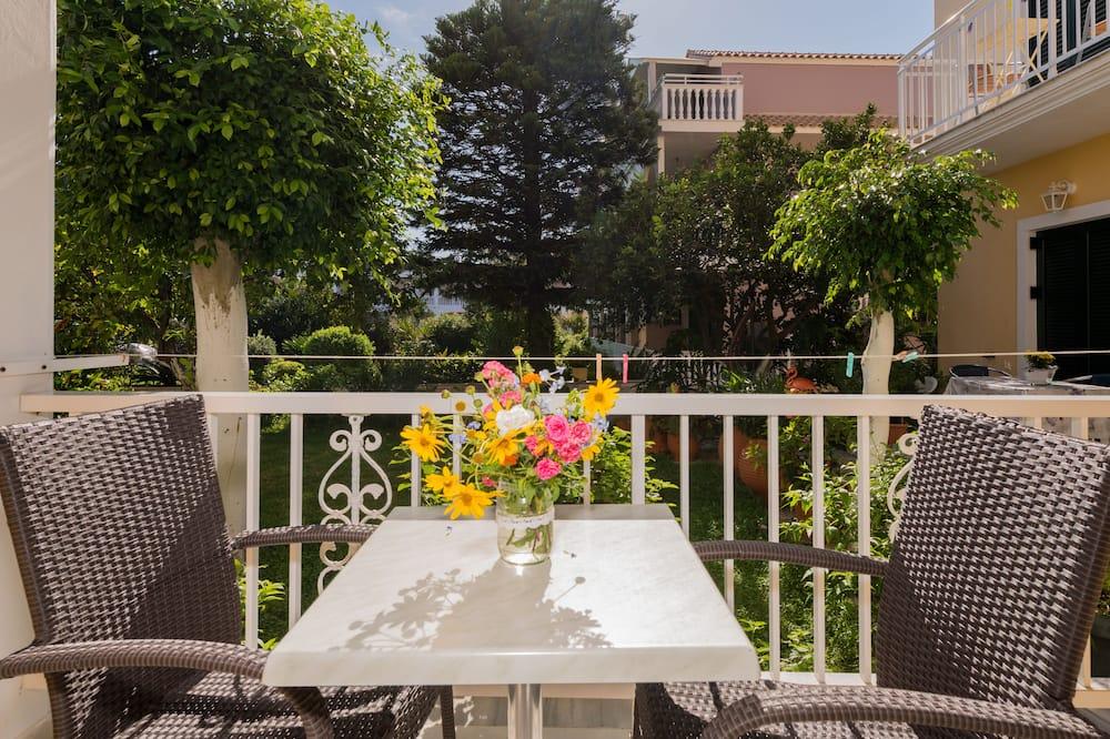 Τρίκλινο Δωμάτιο, Θέα στον Κήπο - Μπαλκόνι