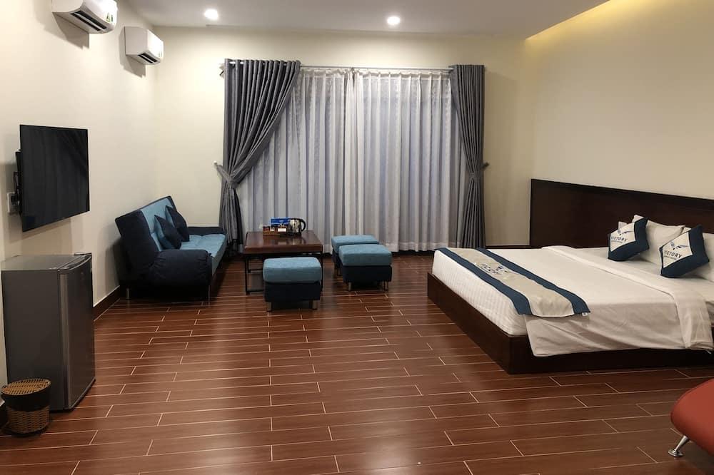 Президентский люкс, 1 двуспальная кровать «Кинг-сайз» с диваном-кроватью, балкон, вид на город - Зона гостиной