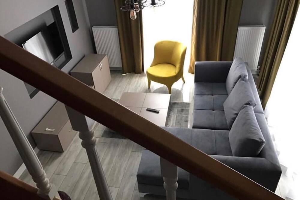 Executive-huoneisto - Olohuone