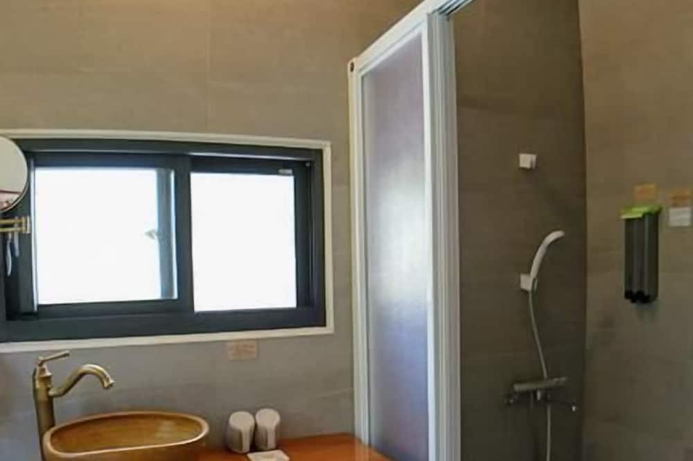 Liukso klasės keturvietis kambarys - Vonios kambarys
