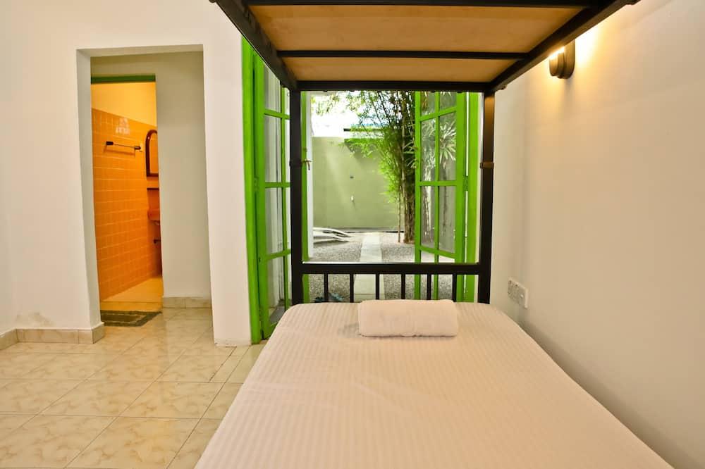 Dormitorio condiviso, dormitorio misto, patio, vista giardino - Camera