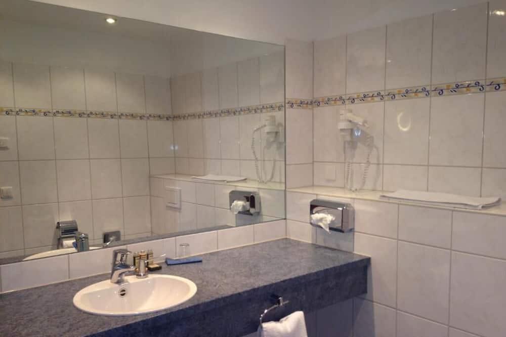 Habitación individual Confort - Lavamanos en el baño