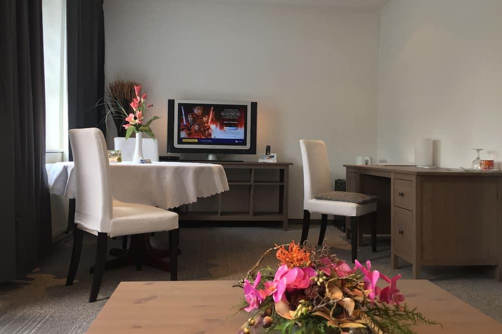 Comfort Suite, 1 Bedroom, Non Smoking, Balcony - Living Area