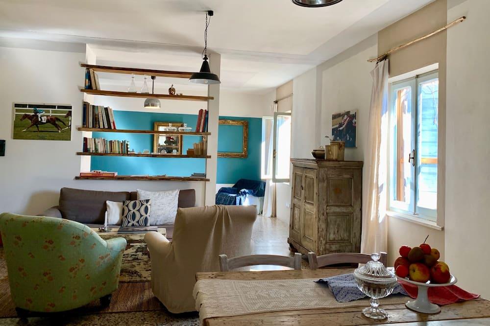 apartman, 1 hálószobával, teraszos udvar, kilátással a völgyre (Torricella) - Nappali