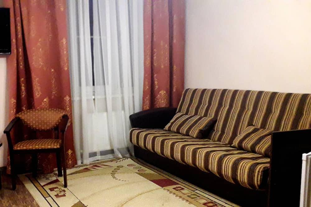 غرفة عائلية رباعية - سرير ملكي مع أريكة سرير - لغير المدخنين - منظر للمدينة - منطقة المعيشة