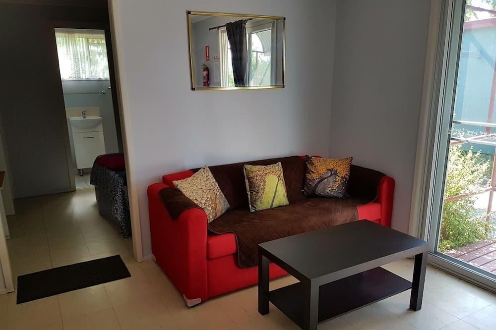 Cabaña clásica, 1 cama doble con sofá cama, para no fumadores, vista al jardín - Sala de estar
