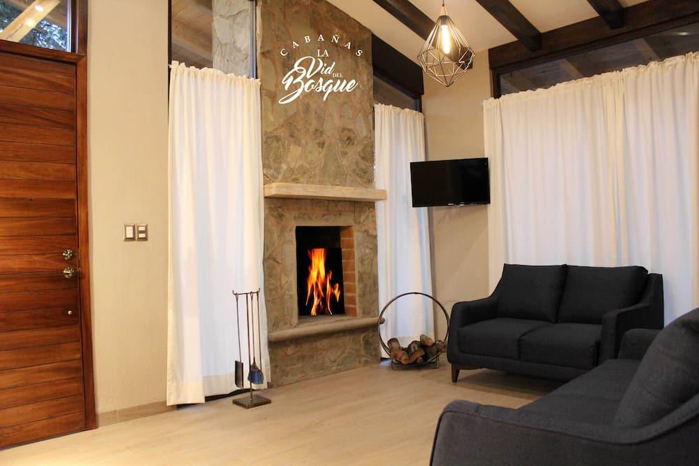 Familie-feriehus - flere senge - ikke-ryger - udsigt over resort - Stue