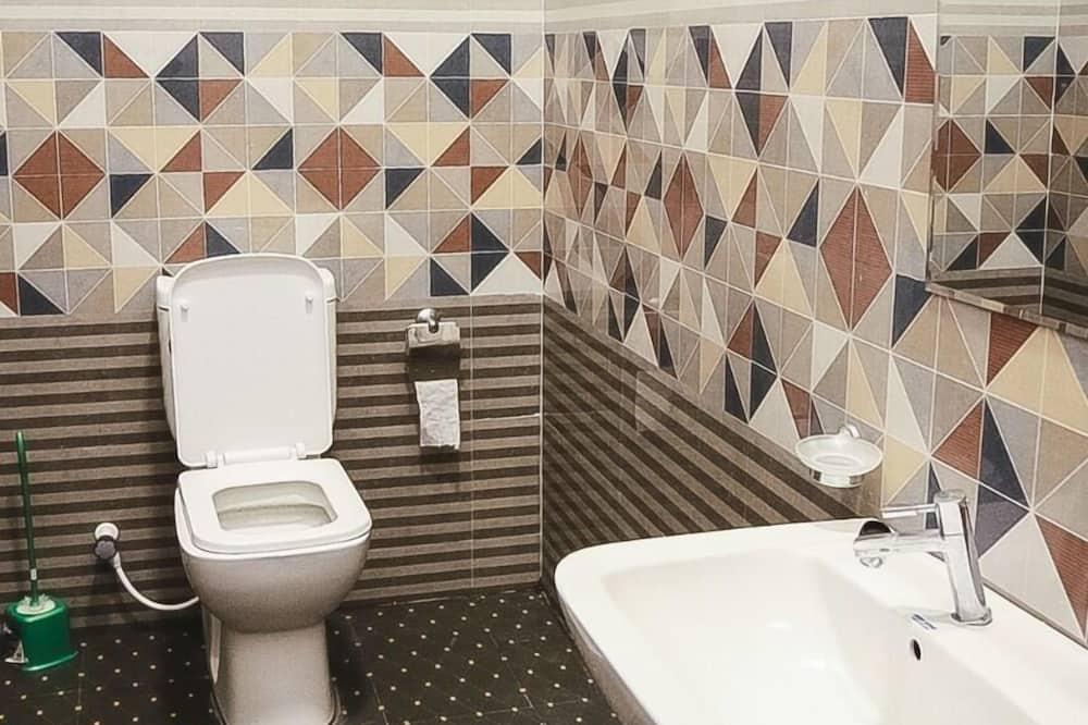Четырехместный номер «люкс» - Раковина в ванной комнате