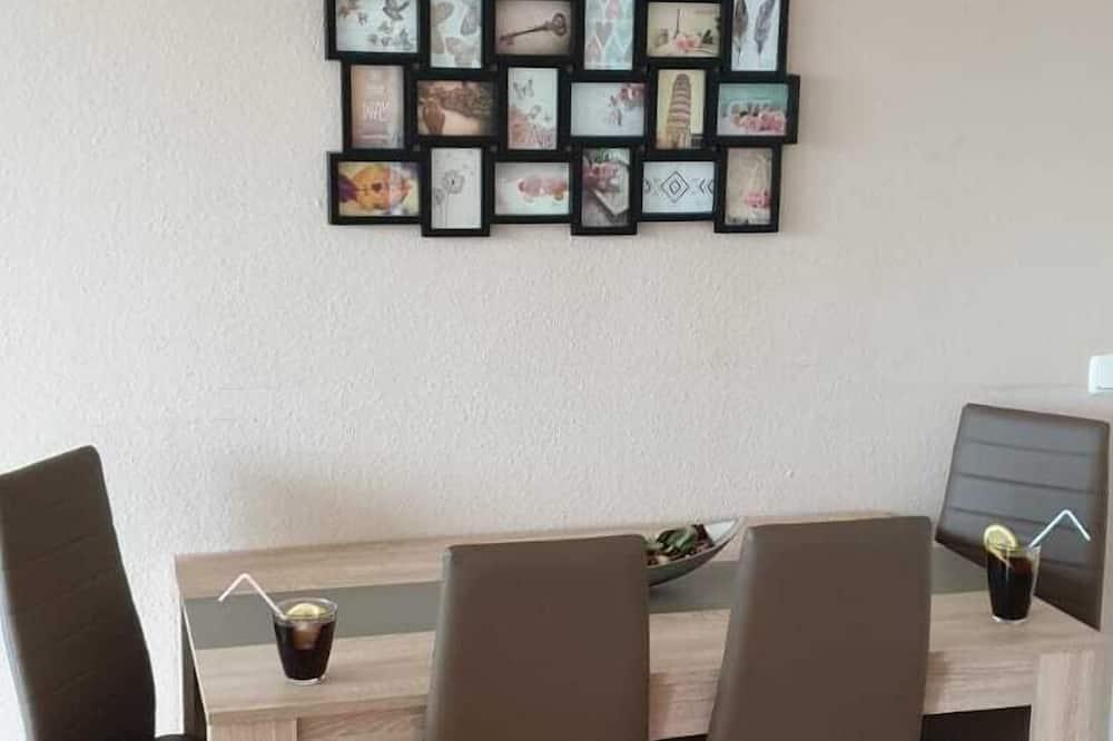 Appartement - Eetruimte in kamer