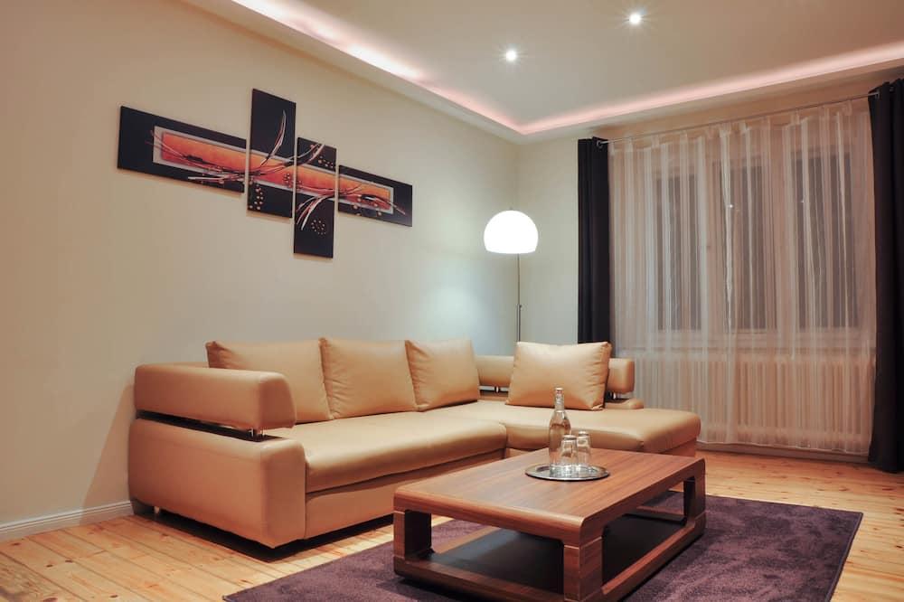 Premium appartement, Uitzicht op de stad - Woonkamer