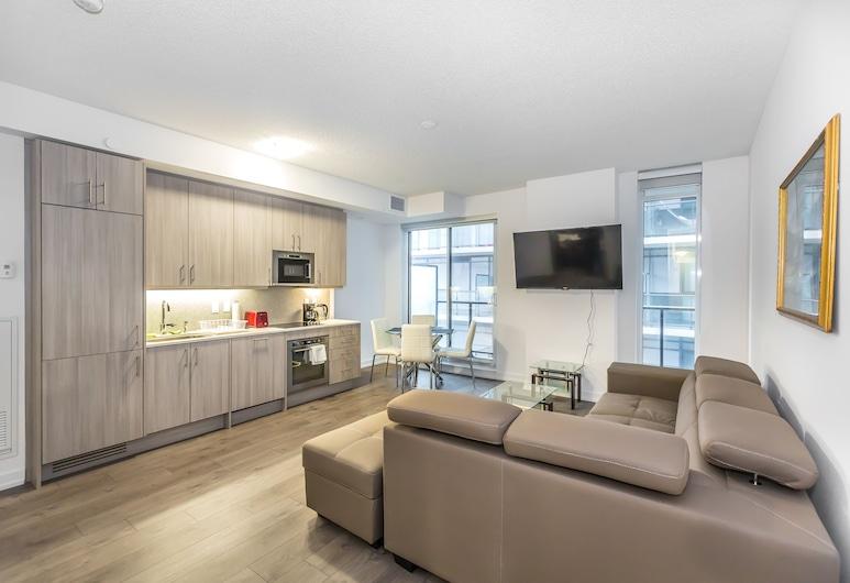 Toronto Furnished Living College Street Elevate Rooms., Toronto, Deluxe appartement, 1 queensize bed, niet-roken, Uitzicht op de stad, Woonruimte