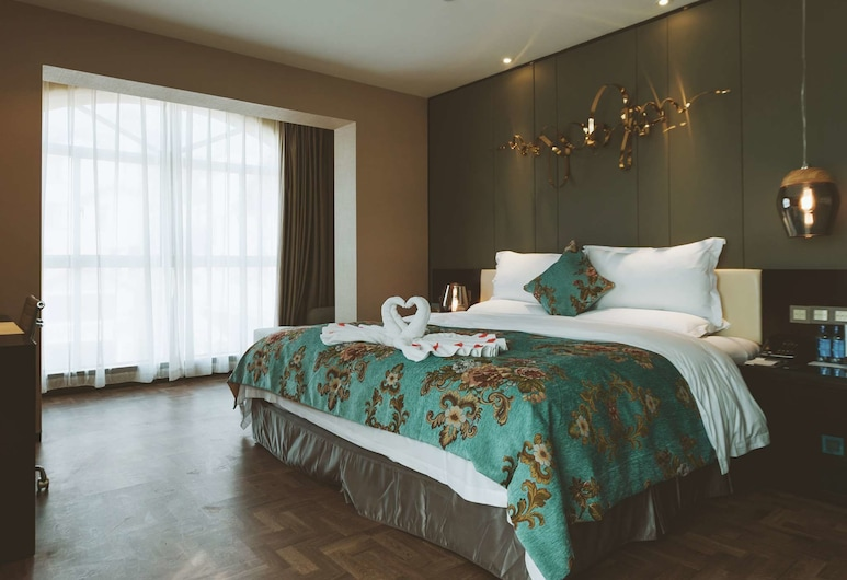 Tulip Inn Huaxi Hotel - Guiyang, Guiyang, Suite, 1 kingsize-seng, Gjesterom