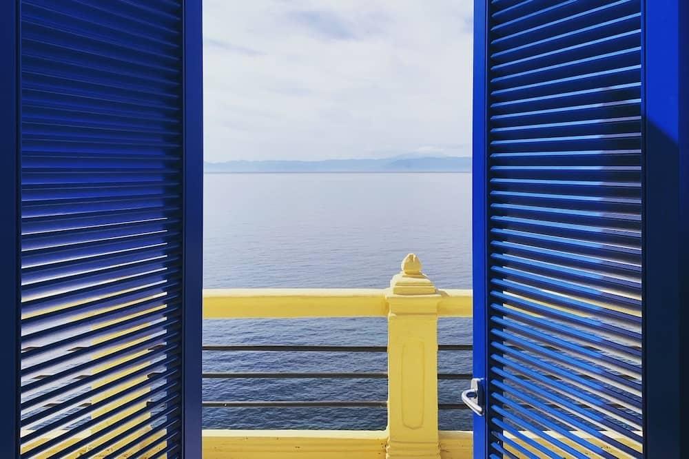 Deluxe Δίκλινο Δωμάτιο (Double ή Twin), Βεράντα, Θέα στη Θάλασσα - Δωμάτιο επισκεπτών