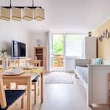 Obiteljski apartman, Više kreveta, za nepušače, pogled na vrt - Dnevna soba