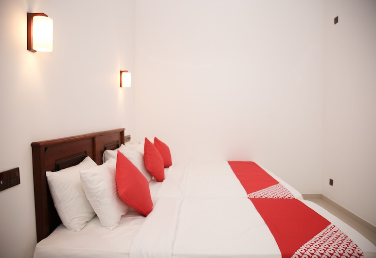 OYO 495 H M C Hotel Leisure House, Девинувара, Трехместный номер «Делюкс», Номер