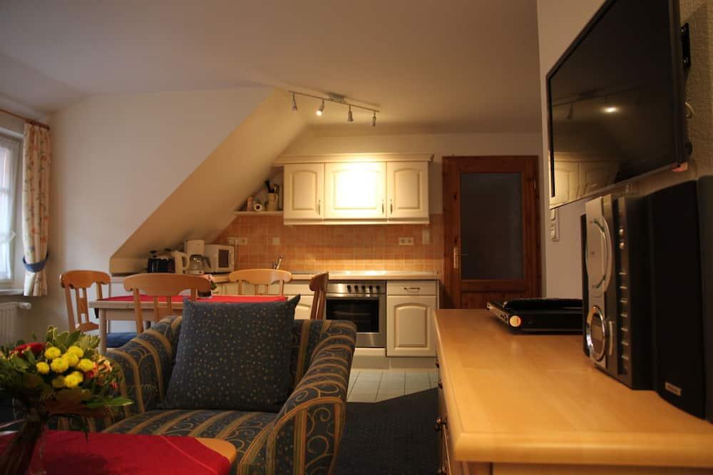 Apartamento Familiar, várias camas, Vista para o Pátio - Área de Estar