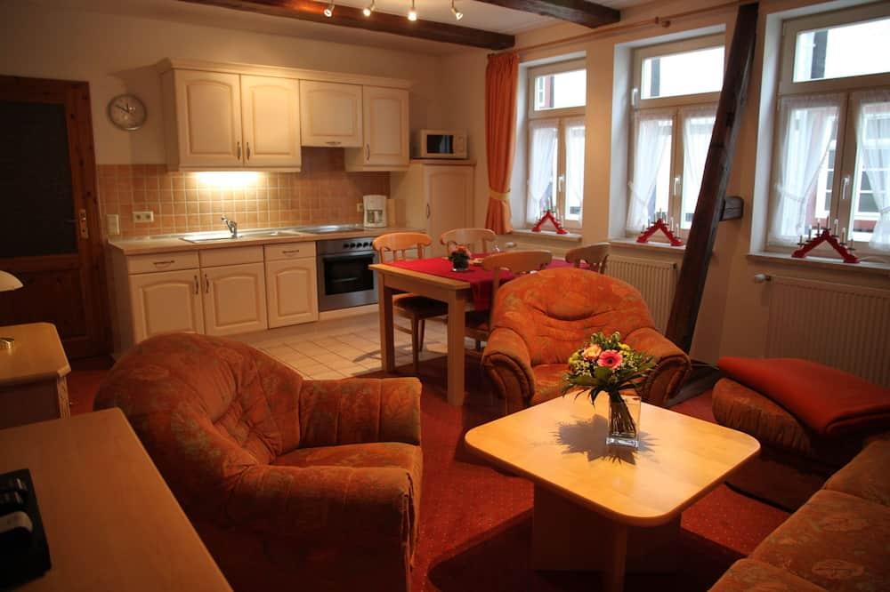 Apartamento Comfort, várias camas, Vista para o Pátio - Sala de Estar