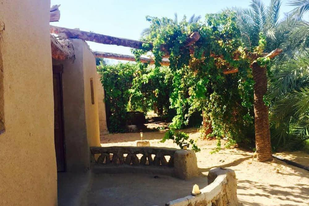 Bungalo, 1 divguļamā gulta vai 2 dvīņu gultas, koplietojuma vannasistaba - Skats uz dārzu