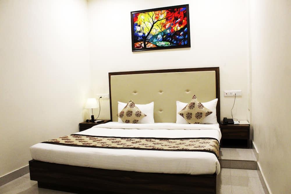 غرفة عادية - سرير ملكي - تجهيزات لذوي الاحتياجات الخاصة - لغير المدخنين - غرفة معيشة